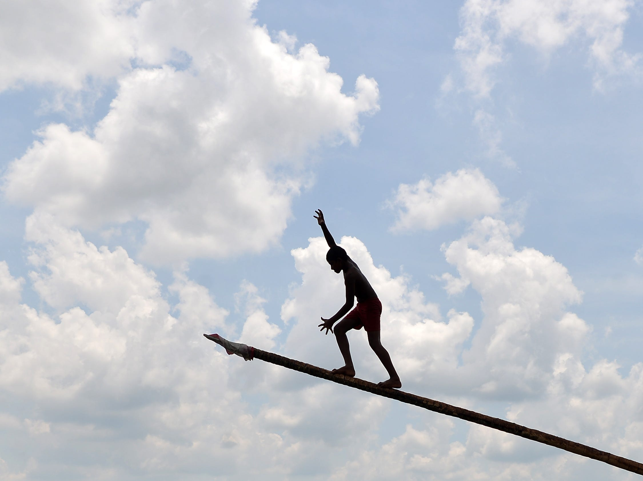 April 22, 2018: A Sri Lankan youth climbs a pole during a game played as part of the Sinhala and Tamil New Year celebrations in Bandaragama near Colombo. The new year, marked by both the majority Sinhalese and minority Tamil population, fell on April 14.
