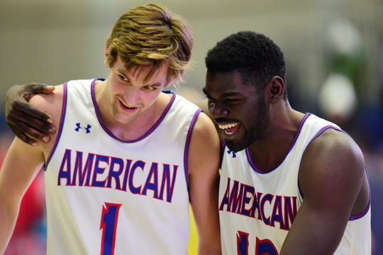 American University Eagles forward Yilret Yiljep (12) walks off the court with forward Jesse Little (1) after the game against the New Hampshire Wildcats on Nov. 16, 2018 in Washington.