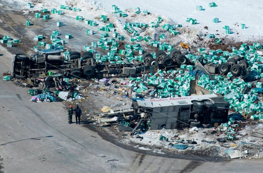 April 7, 2018: Emergency personnel work at the scene of a fatal crash outside of Tisdale, Saskatchewan, Canada. A bus en route to Nipawin, foreground, carrying the Humboldt Broncos junior hockey team crashed into a truck Friday night, killing 14 and sending over a dozen more to the hospital.