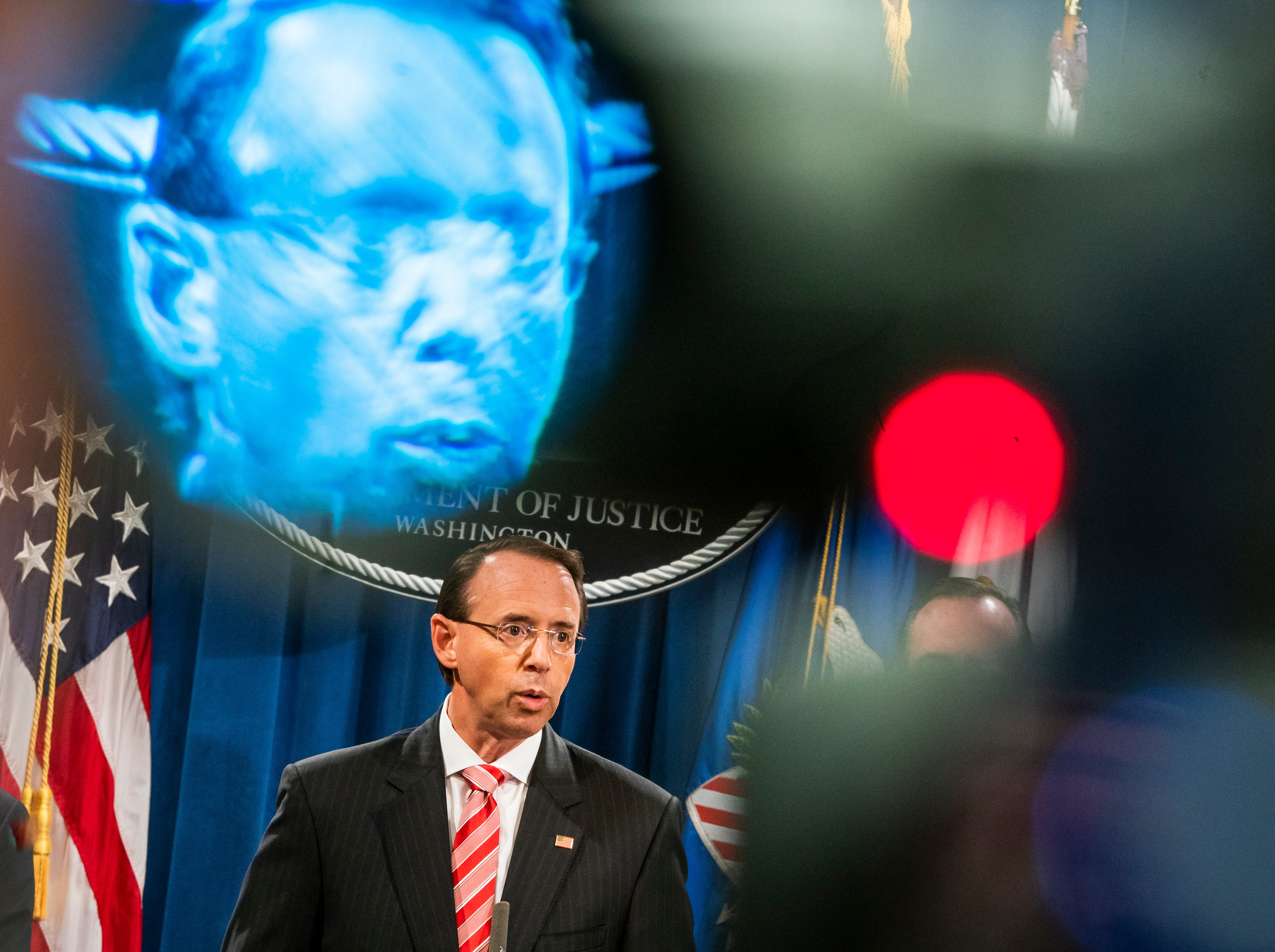 July 13, 2018: Deputy Attorney General Rod Rosenstein is seen in the viewfinder of a television camera as he announces that the Justice Department is indicting 12 Russian military officers for hacking Democratic emails during the 2016 presidential election at the Justice Department in Washington. The Russians involved were working for the military intelligence service GRU, according to Rosenstein.