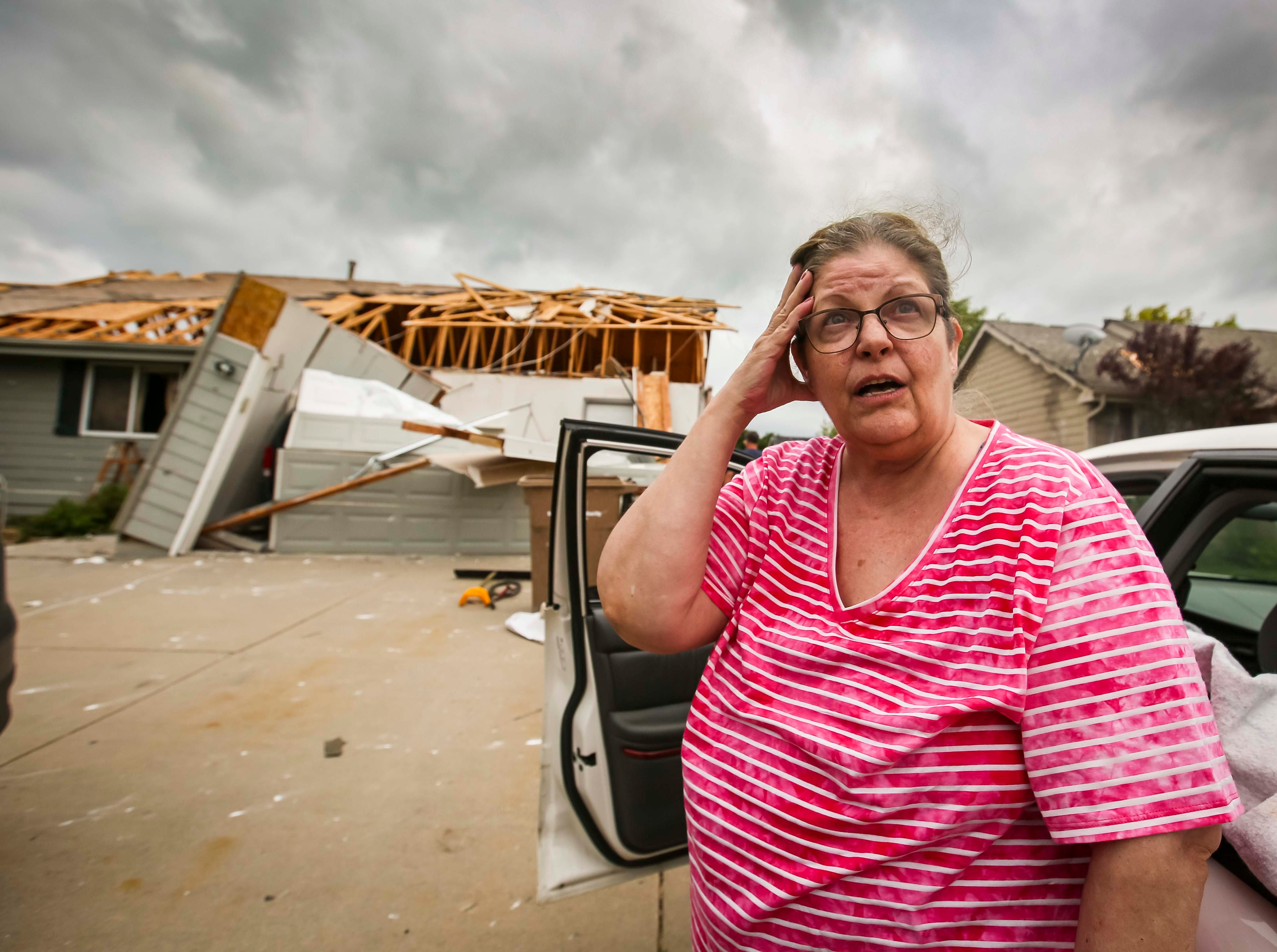 July 20, 2018: Susan Ratliff's home is destroyed on the west end of Bondurant, Iowa after a tornado slashed through the town. She was on the top step of her basement stairs when it hit the home.