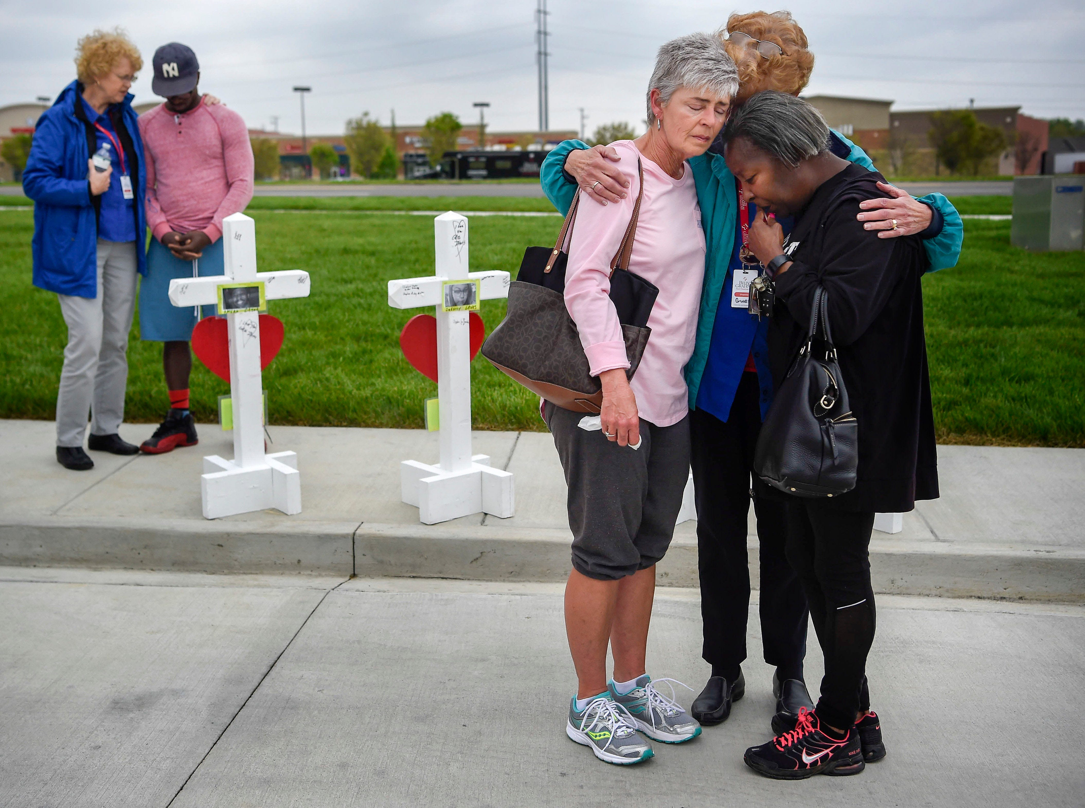 April 25, 2018: Antioch, TN, USA; Members of the Billy Graham Rescue Response Team pray with Lancelot DeSilva, far left, Susan Cox and Valerie Aaron at the memorial for the four people that were killed on April 22 at the Waffle House in Antioch, Tenn.