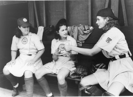 From left, Rosie O'Donnell, Madonna and Geena Davis shoot a scene from the 1992 film A League of Their Own, based on the All-American Girls Professional Baseball League and the Racine Belles.
