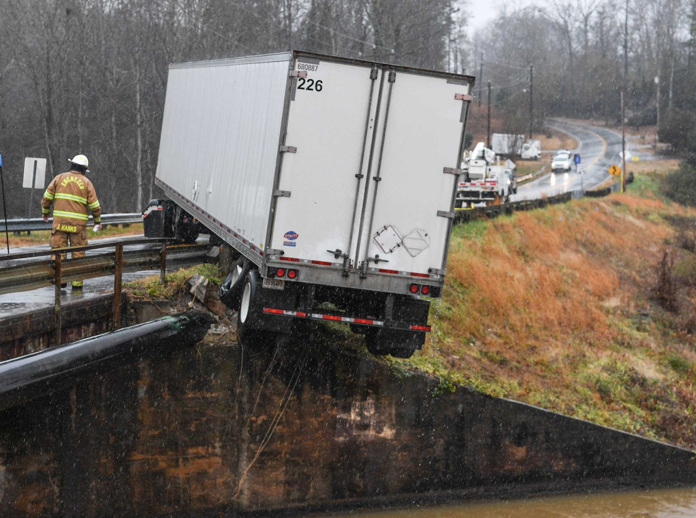 The rear end of an 18-wheeler went off the road at Broadway Lake near Paul's Landing in Anderson Thursday. Emergency workers, Ebenzer fire, Medshore and State Troopers responded and the bridge was blocked off for hours.