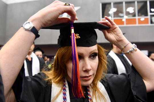 Amanda Nicks prepares for graduation at the Littlejohn Coliseum.