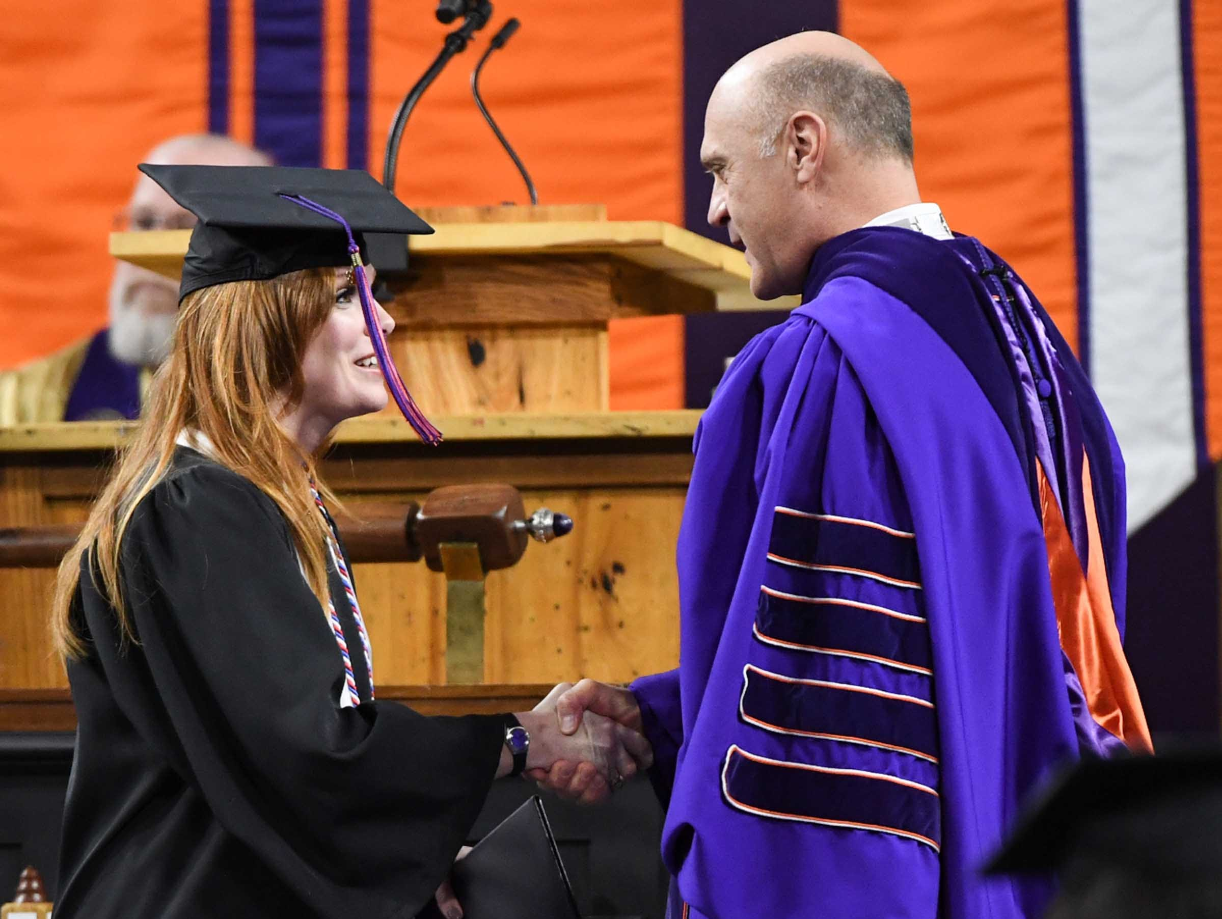 Amanda Nicks gets her diploma for pyschology and shakes hands with President Jim Clements during Clemson University graduation ceremony Thursday morning in Littlejohn Coliseum in Clemson.