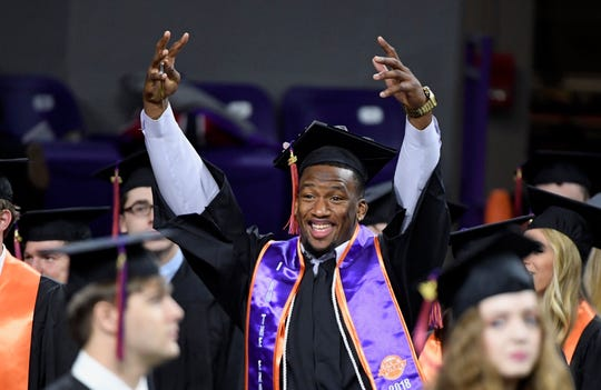 Clelin Ferrell, a Clemson football player, celebrates during the graduation ceremony at Clemson University on Thursday, Dec. 20, 2018.