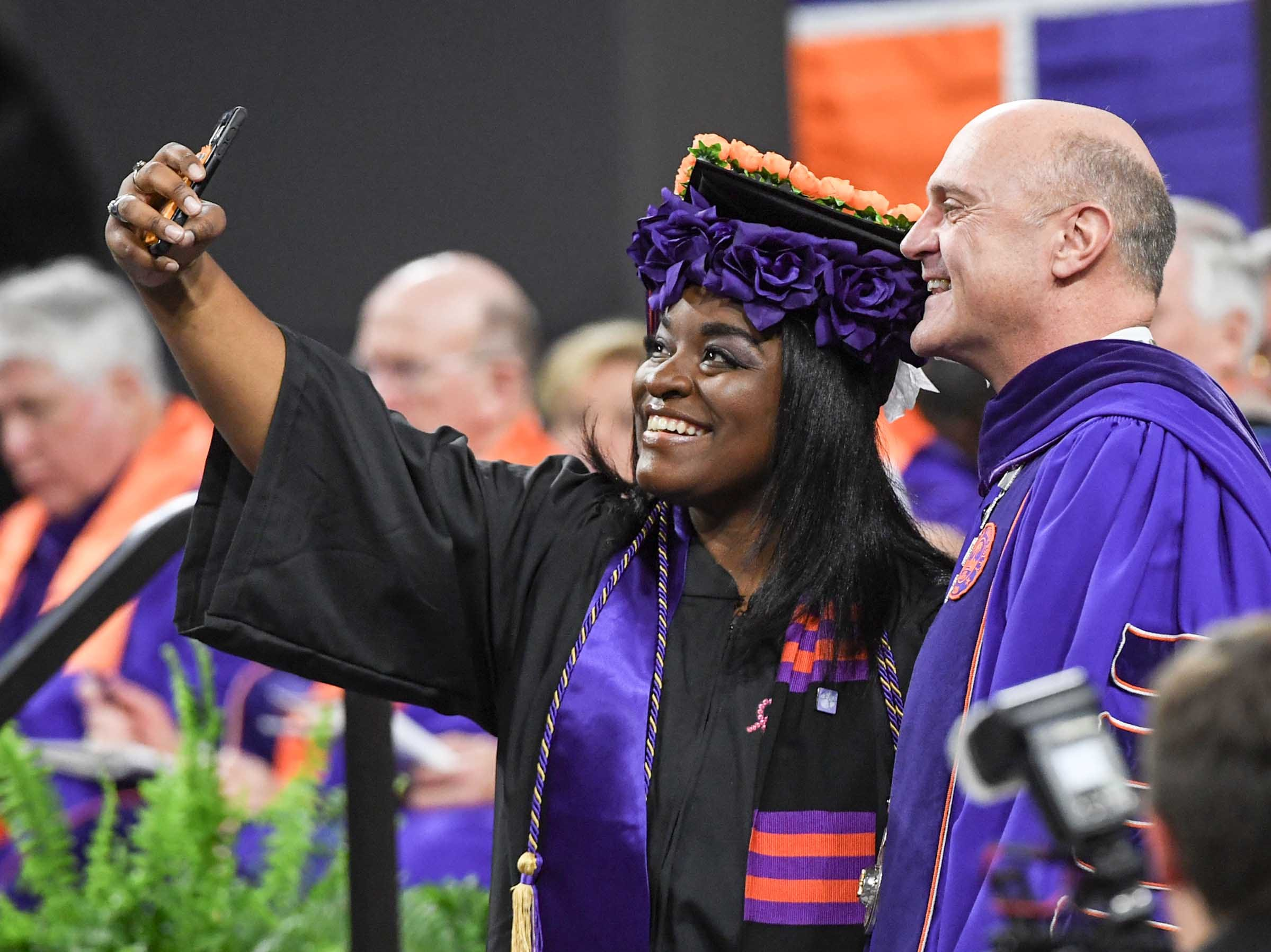Dorothy Davis gets a selfie with President Jim Clements during Clemson University graduation ceremony Thursday morning in Littlejohn Coliseum in Clemson.
