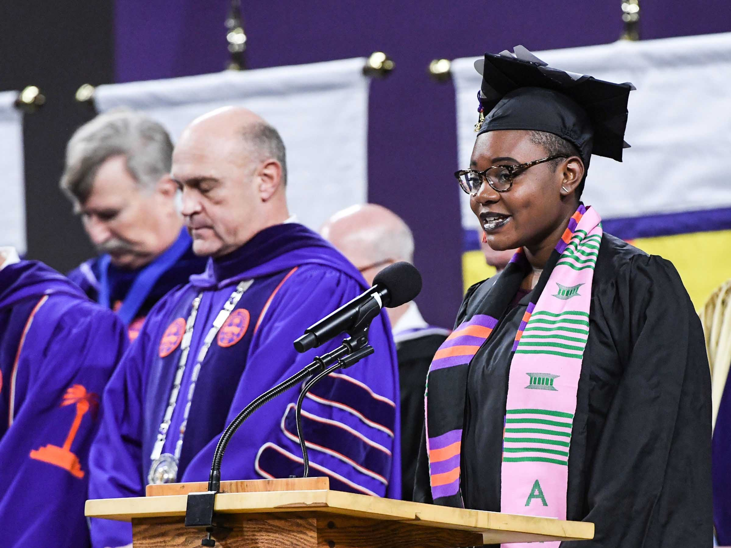 Barbara Chrystyna Dinkins, right, offers the invocation near President Jim Clements, middle, during Clemson University graduation ceremony Thursday morning in Littlejohn Coliseum in Clemson.