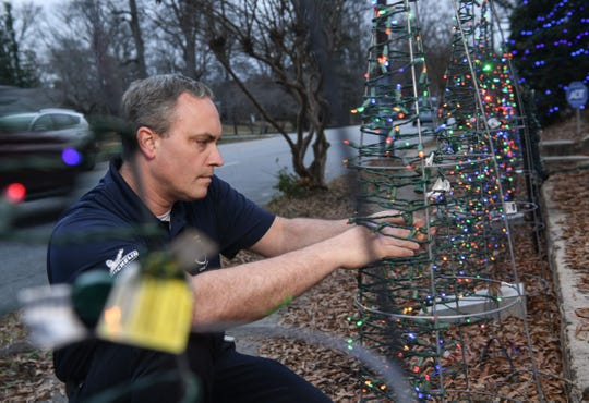 David Clardy puts his engineering skills to use every Christmas when he sets up his Christmas lights display on North Avenue. The former AFCO employee now works at Michelin's Earthmover tire plant.