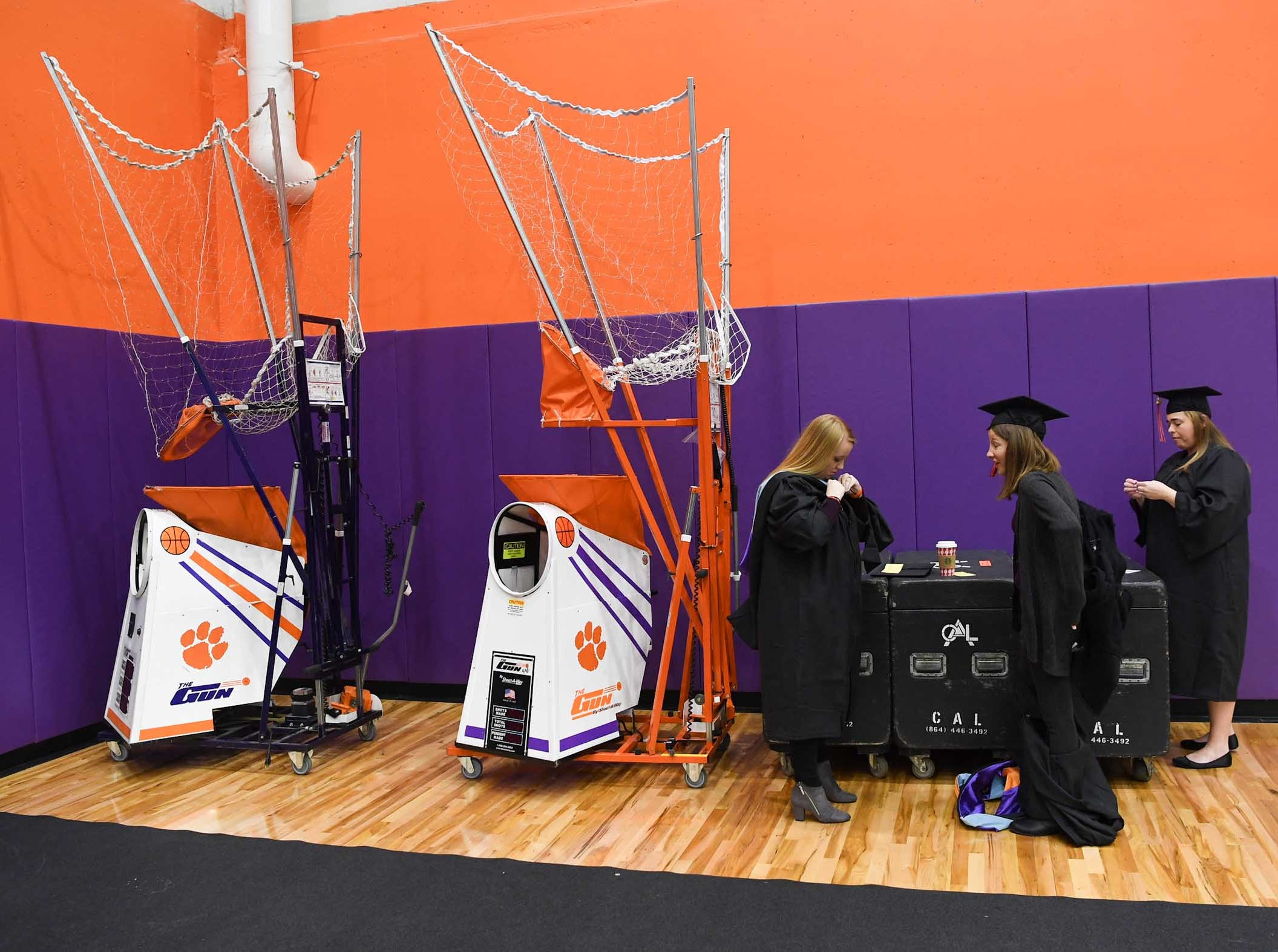 Graduates prepare for the morning Clemson University graduation ceremony Thursday morning in Littlejohn Coliseum in Clemson.