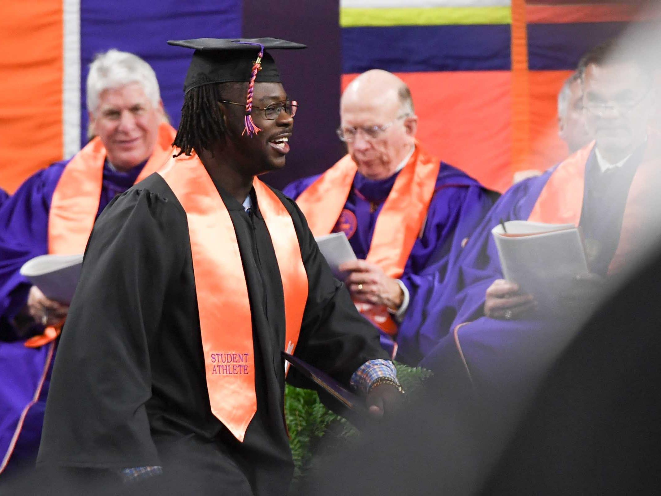 Clemson defensive lineman Albert Huggins during Clemson University graduation ceremony Thursday morning in Littlejohn Coliseum in Clemson.