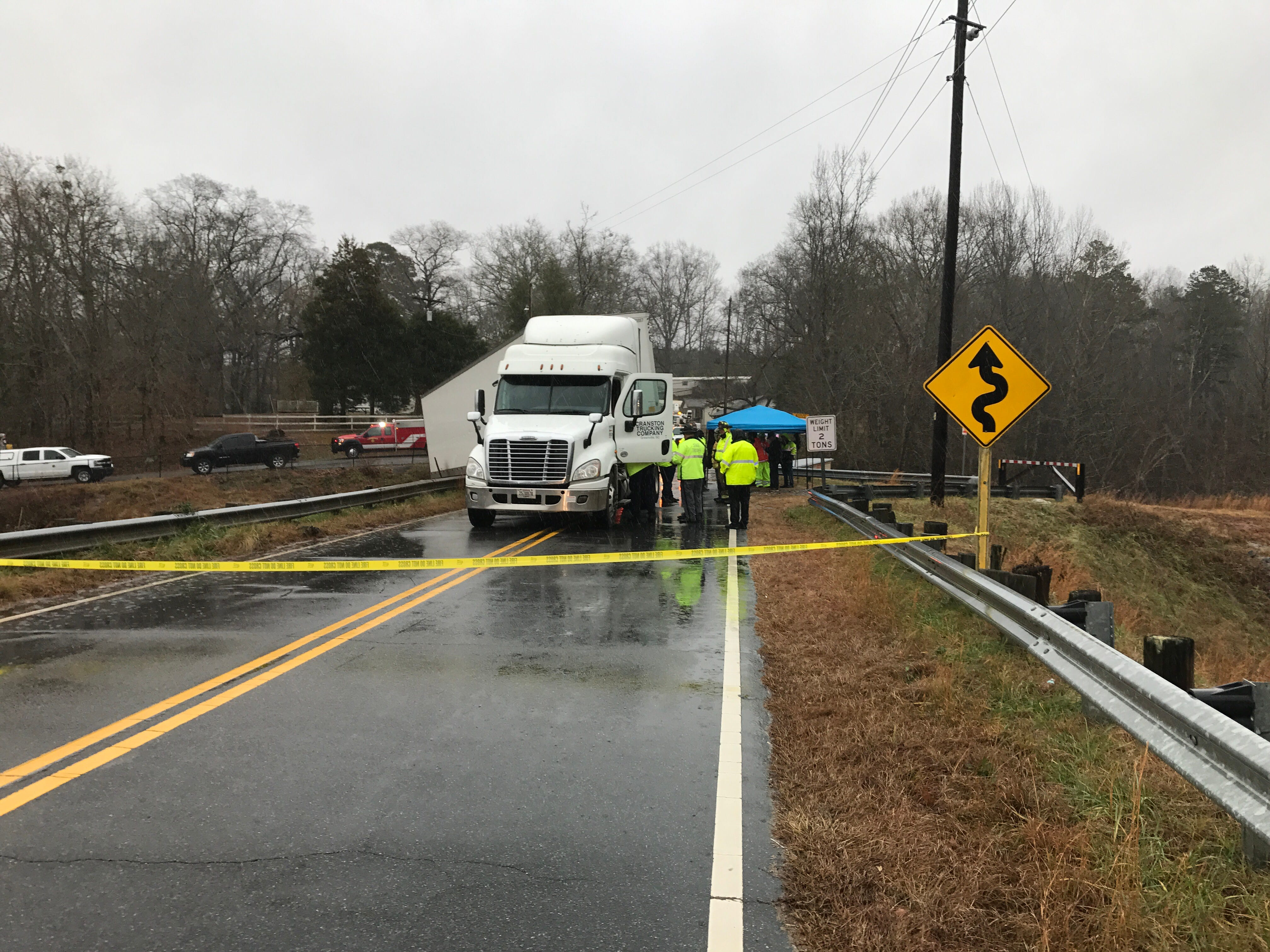 A truck attempting to back up off Broadway Lake Bridge went over the guardrail, according to the S.C. Highway Patrol.