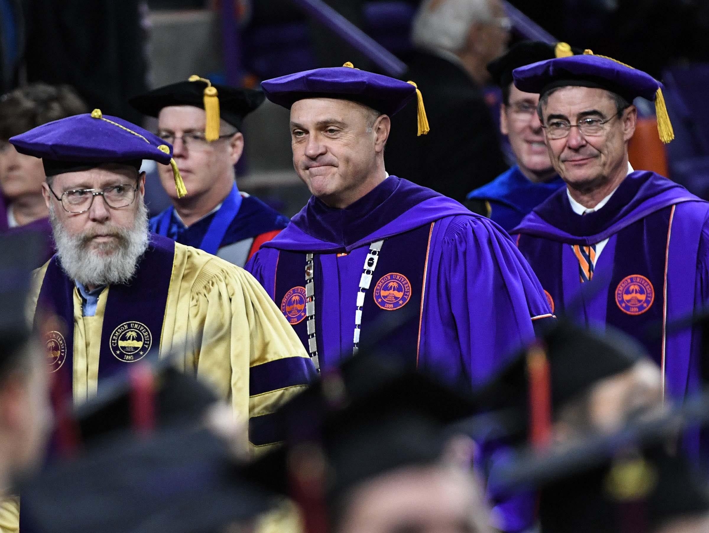 President Jim Clements, middle, during Clemson University graduation ceremony Thursday morning in Littlejohn Coliseum in Clemson.