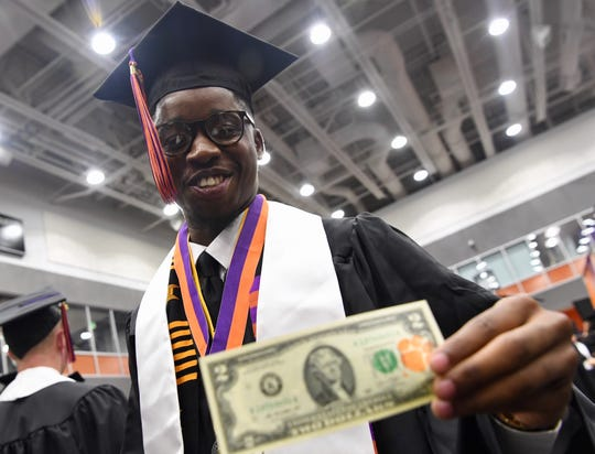 Willie Webb prepares for graduation at the Littlejohn Coliseum.