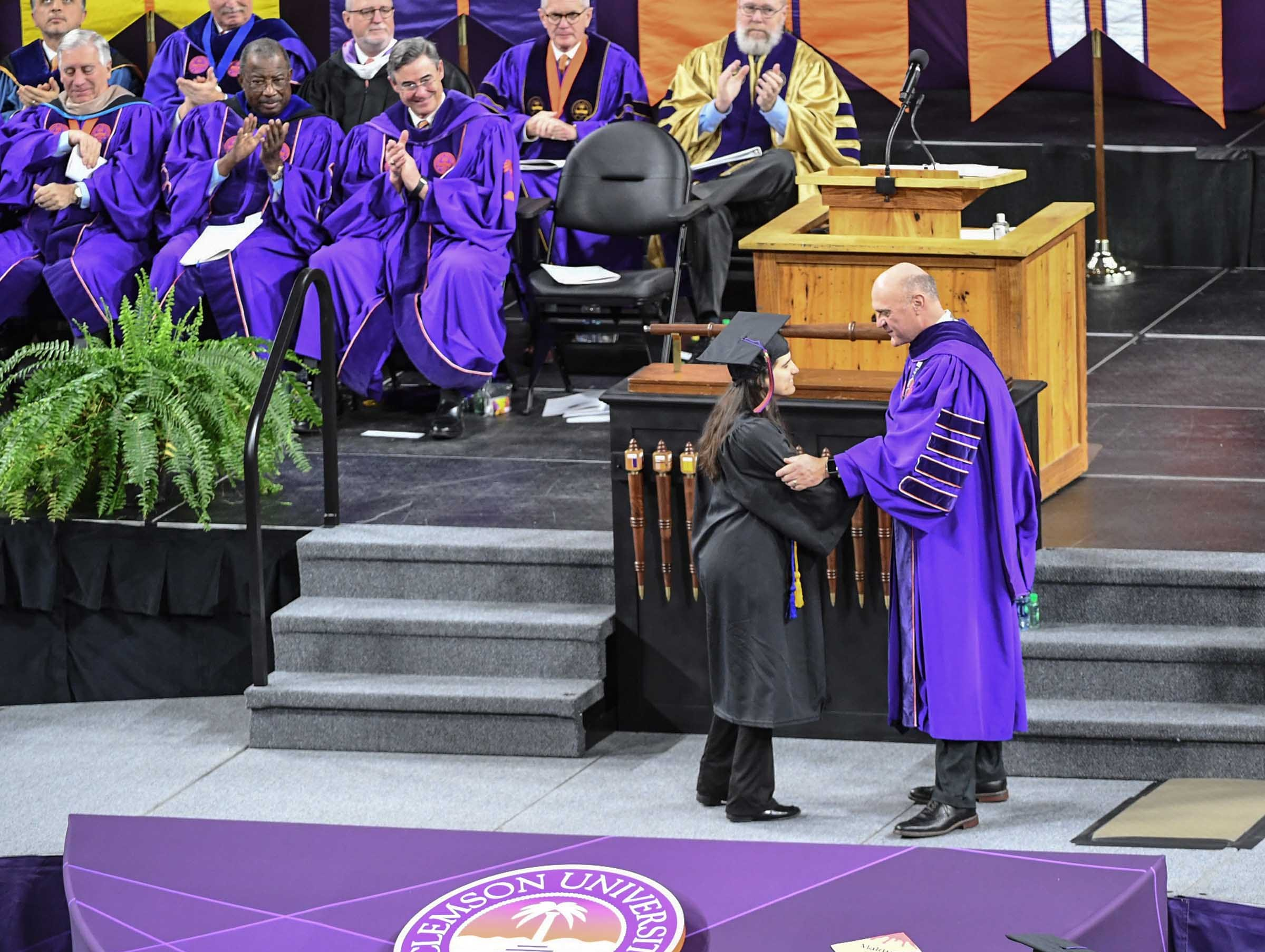 Miriam Lozneanu,  who is nearly blind and deaf, shakes hands with President Jim Clements during Clemson University graduation ceremony Thursday morning in Littlejohn Coliseum in Clemson. She graduated Thursday with a degree from the College of Engineering, Computing and Applied Sciences at Clemson University.