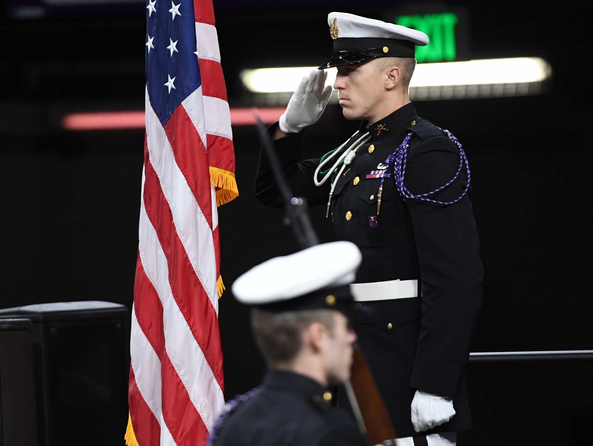 Clemson University Pershing Rifles C-4 post colors for the National Anthem during Clemson University graduation ceremony Thursday morning in Littlejohn Coliseum in Clemson.