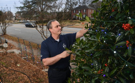 David Clardy, who recently changed jobs and works as an engineer at the Michelin Starr Earthmover Facility in Anderson County, also leads his neighborhood Christmas lights display on North Avenue.