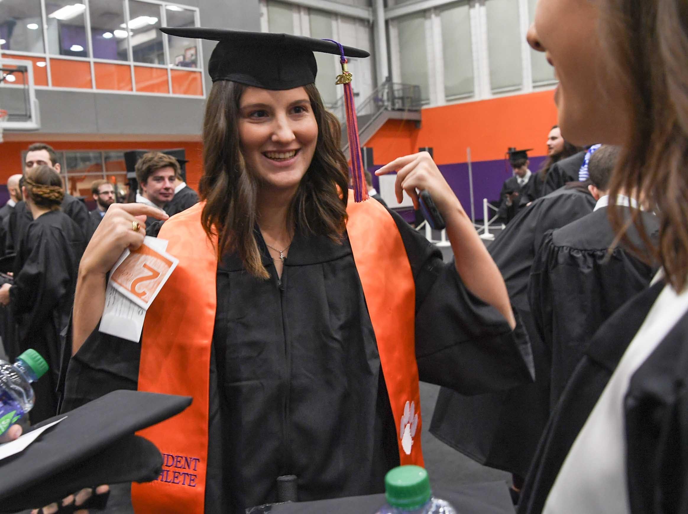 Sydney Legacy, women's golf, gets ready for Clemson University graduation ceremony Thursday morning in Littlejohn Coliseum in Clemson.