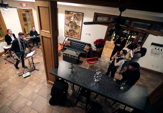 Jazz musicians Ross Catterton, Zach Harmon, Noah Harmon and Gordon Lewis perform at a pre-opening private party at 313 Dodge in Kaukauna.