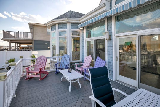 The home has a wonderful deck with oversized sliders with an inground pool.