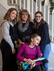 Erin Price is surrounded by her family, Kim, mom, center, and sisters Mackenzie, left, and Morgan, right.