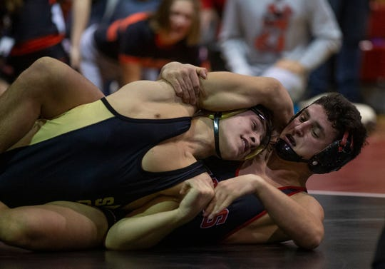 Jackson Memorial's Carsten DiGiantomasso (right) recorded a key win over Nicholas Pepe in Jackson Memorial's 28-25 win over Southern Wednesday night