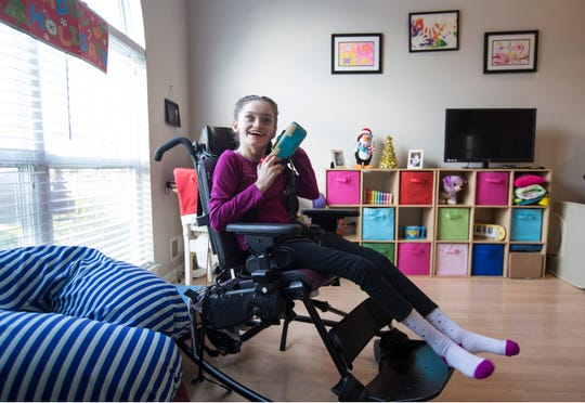 Erin Price, 12, in her Howell home.