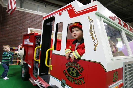 Brennan Glazier, 2, of Colts Neck plays inside a make-believe fire engine at Magic Sky Play in Marlboro, a 4,500-square-foot indoor play place for kids that can be hired for parties, classes, camp trips, etc., in Marlboro., NJ Thursday, December 20, 2018.