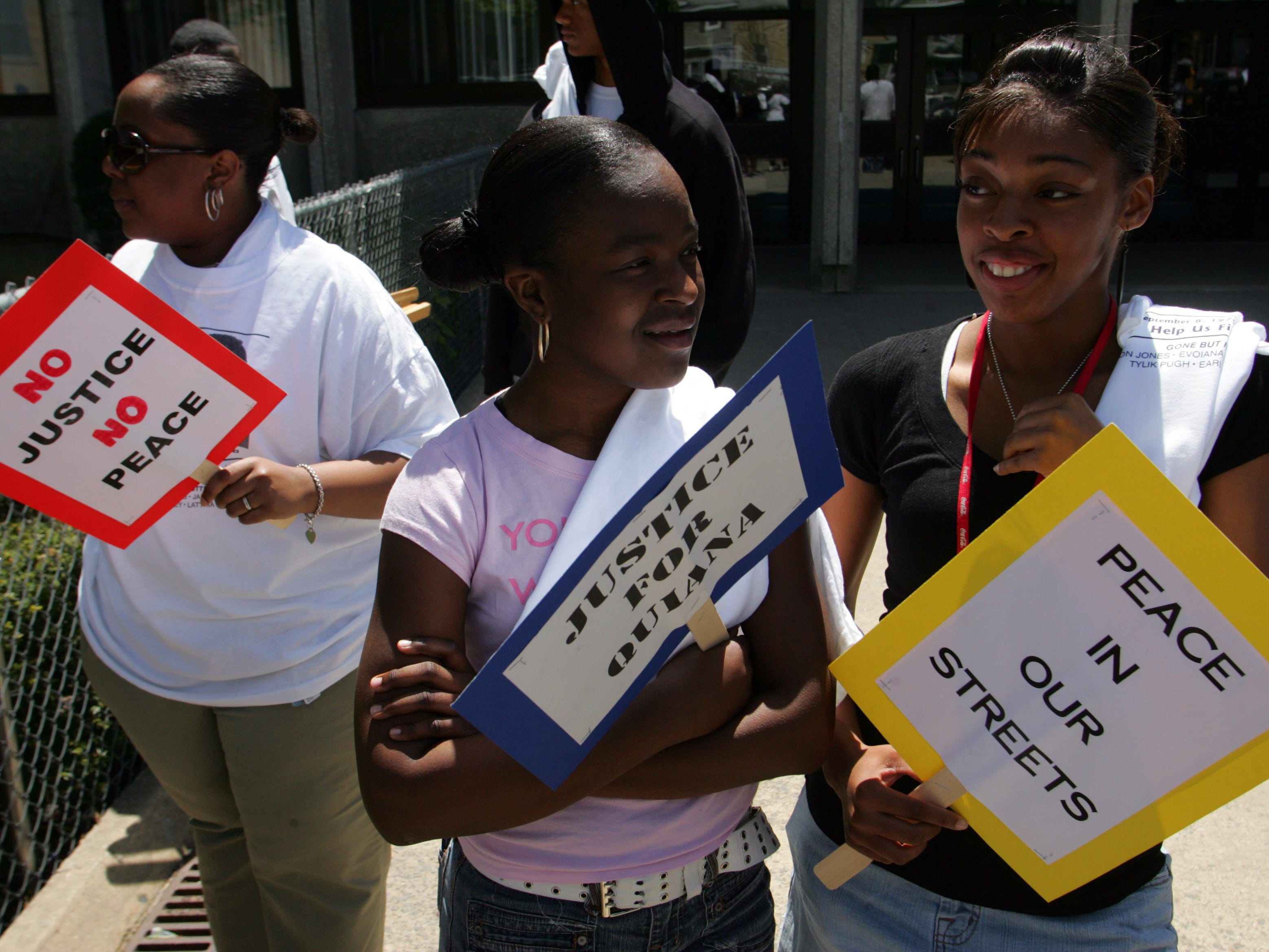 Asbury Park 05/05/07 -- Nicole Young, Asbury Park, left to right, Ashley Hosea, 14, Neptune, and LaTasia Ivory, 15, Neptune, hold their signs before participating in the Justice for Quiana Dees march, in front of Asbury Park Middle School.