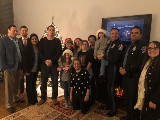 Marlboro police  captain Pete Pezzullo (third from right) and other do-gooders make a special delivery to the Giannotti family.