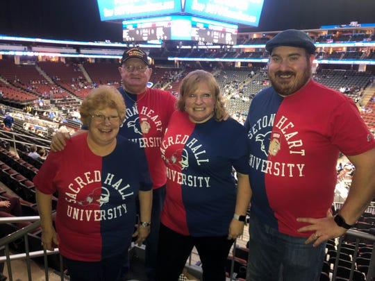 Dolly Janus, Bob Janus, Cheryl McCloskey and Ryan McCloskey display half-Seton Hall, half-Sacred Heart shirts.