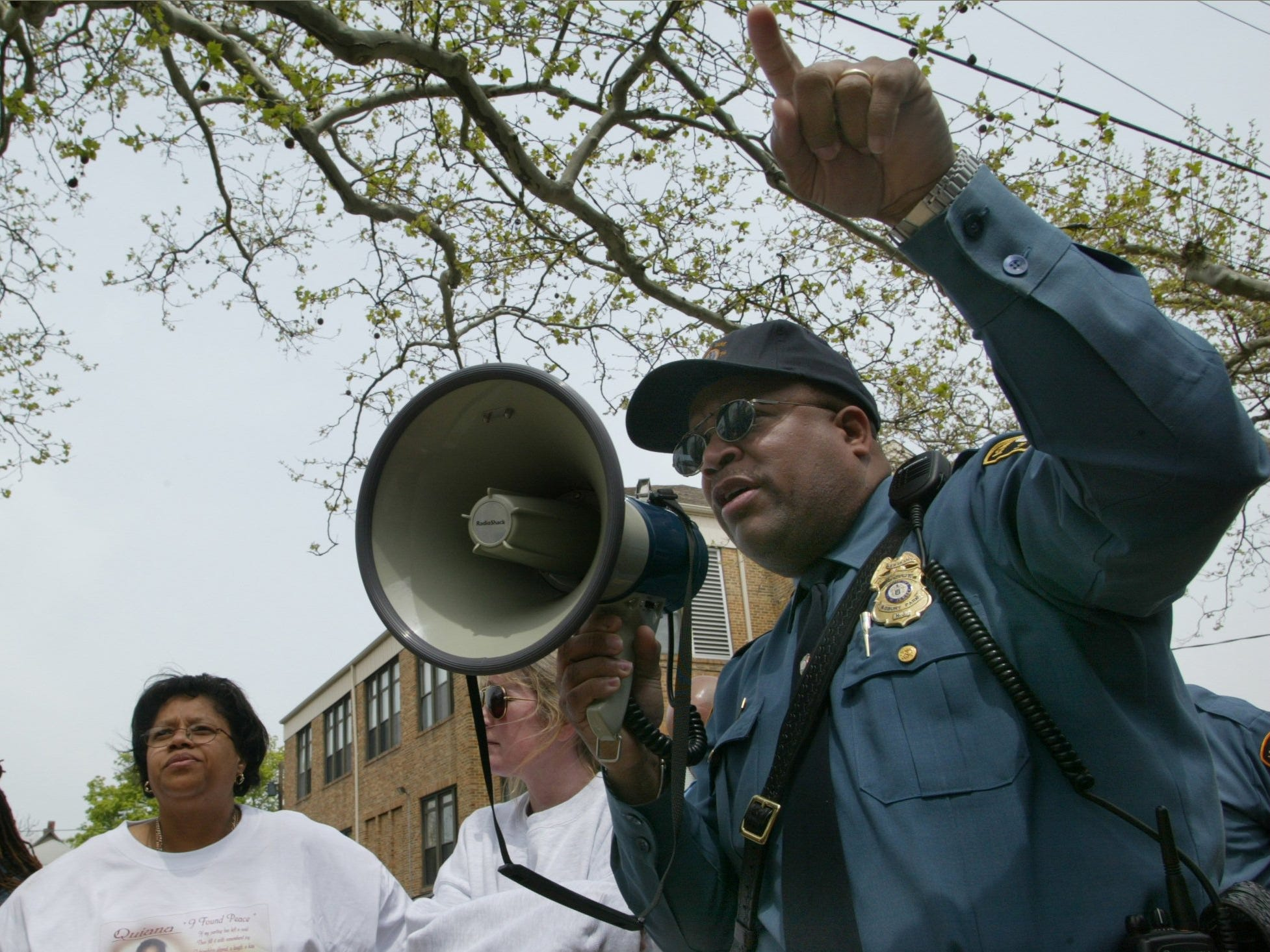 5/3/03-Asbury Park- Asbury Police Sgt. George Corbin gives instructions to crowd gathered for the 11th annual Quiana Dees March for Justice prior to start of walk in Asbury Park.