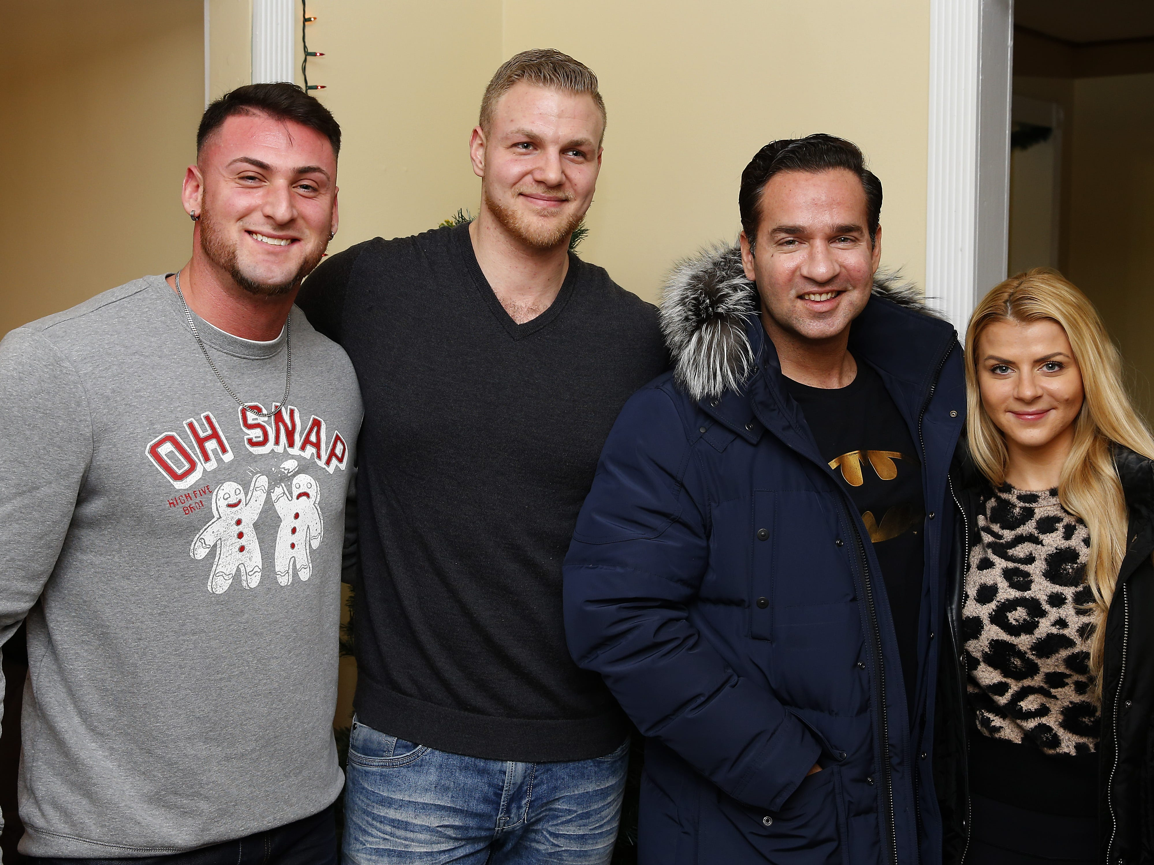 """(left to right) Phoenix Recovery house co-owners Kevin Mirda and Shawn Metz seen with  Mike""""The Situation """" Sorrentino and his wife Loren Sorrentino at the annual Christmas party. Eatontown, N.J.  Wednesday, December 19, 2018 Noah K. Murray-Correspondent/Asbury Park Press"""