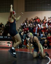 Jackson Memorial's Kyle Epperly celebrates after pinning Southern Regional's Ben LoParo in the 195-pound bout Wednesday night.