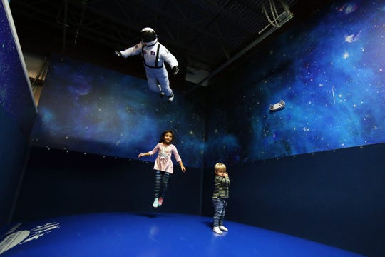 Eliana Wurth, 4, and her one-year-old brother, Harrison, jump on a moon bounce at Magic Sky Play in Marlboro, a 4,500-square-foot indoor play place for kids that can be hired for parties, classes, camp trips, etc., in Marlboro., NJ Thursday, December 20, 2018.