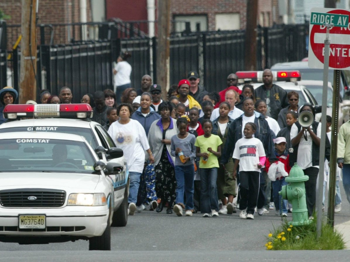 5/3/03-Asbury Park- Photo by - Marchers near the intersection with Ridge Ave as they walk down Washington Ave during the 11th annual Quiana Dees March for Justice in Asbury Park.
