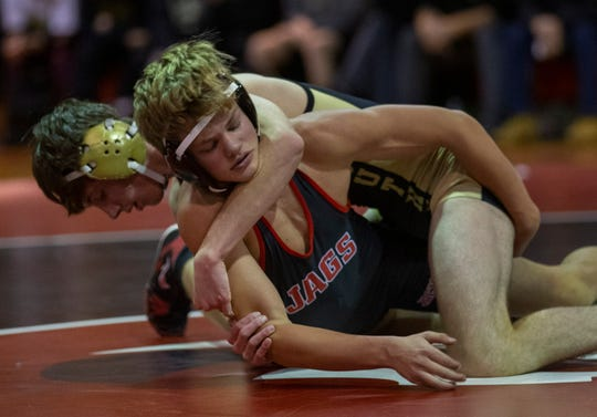 Southern's Robert Woodcock looks for backpoints in the 138-pound bout against  Jackson Memorial's Nick White. Woodcock won by technical fall