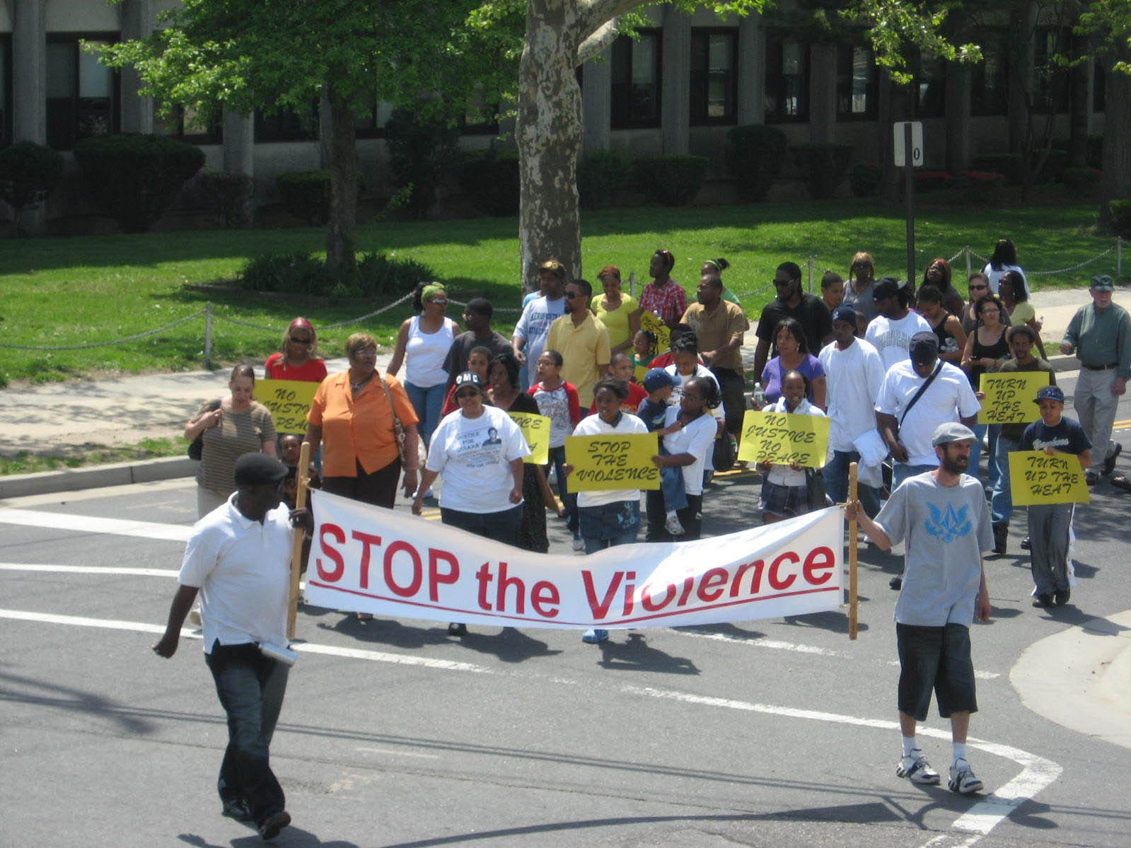 Marchers trace the last steps of murder victim Quiana Dees who was murdered 18 years ago. Asbury Park 5/1/10