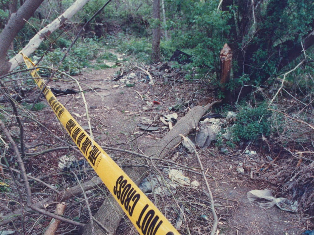 5/5/92 A police line marks the path in woods adjacent to the Mt. Olive Seventh-Day Adventist church in Neptune where Quiana Dees, 12, was found shot in the head Saturday morning.