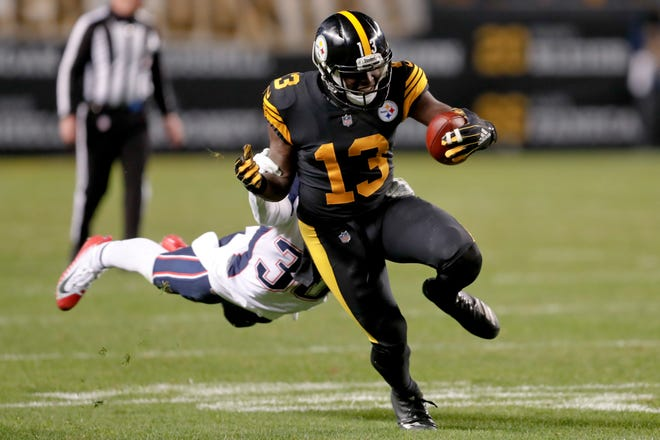 Pittsburgh Steelers wide receiver James Washington (13) tries to shake off a New England defender during an NFL game Sunday, Dec. 16, 2018, in Pittsburgh.