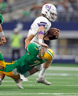 Mason's Klay Klaerner (41) breaks a tackle by New Deal's Jett Whitfield (7) during the 2A division I state championship game against New Deal, Thursday, Dec. 20, 2018, at AT&T Stadium in Arlington.