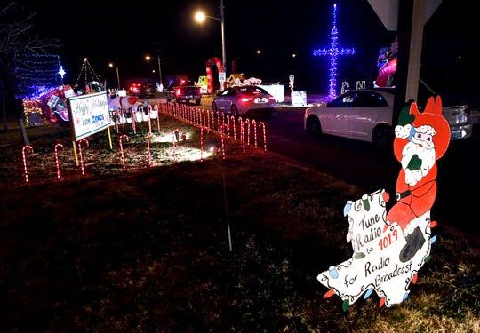 Cars enter Christmas Lane at the Abilene State Supported Living Center Wednesday Dec. 19, 2018.
