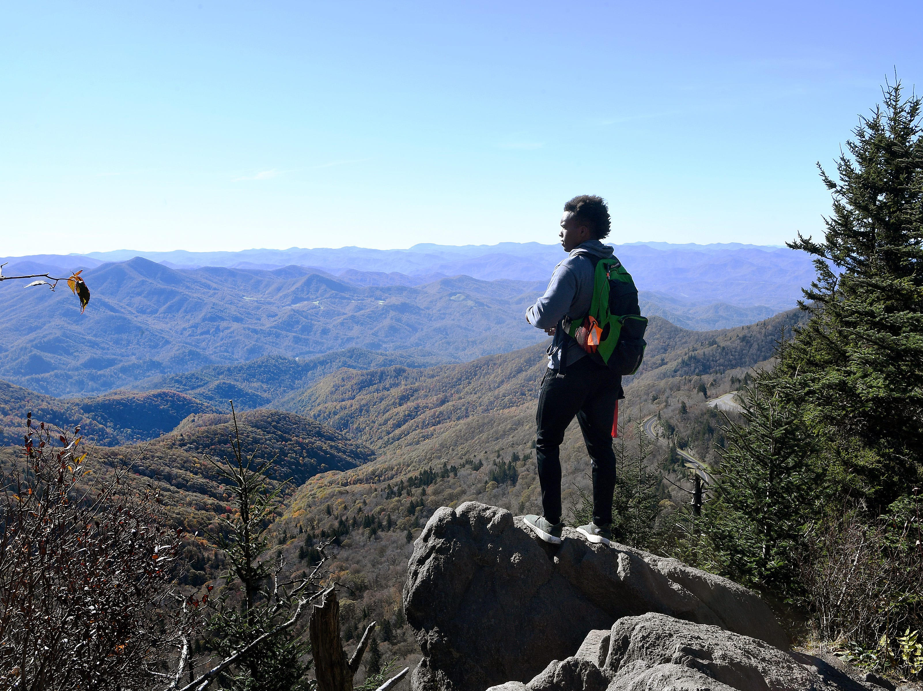 Joshua Perkins takes in the view from the top of Waterrock Knob on the Blue Ridge Parkway in Maggie Valley as he hikes with Pathways to Parks on Tuesday, Oct. 30, 2018. Pathways to Parks is an outdoors group that aims to get more people of color outside and enjoying National Parks.