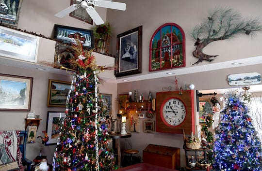 "Each Christmas tree in the Bryans' Waynesville home is decorated according to a theme. In the living room is the ""music tree,"" and the ""ice tree"" is seen in the entranceway. ""We can't buy a present for everybody but we can give ourselves as a present at least once a year,"" Phyllis Bryan said. ""Christmas kind of embodies all of that wanting to be good to your fellow man, woman and child,"" she said about the effort she puts into decorating for Christmas."