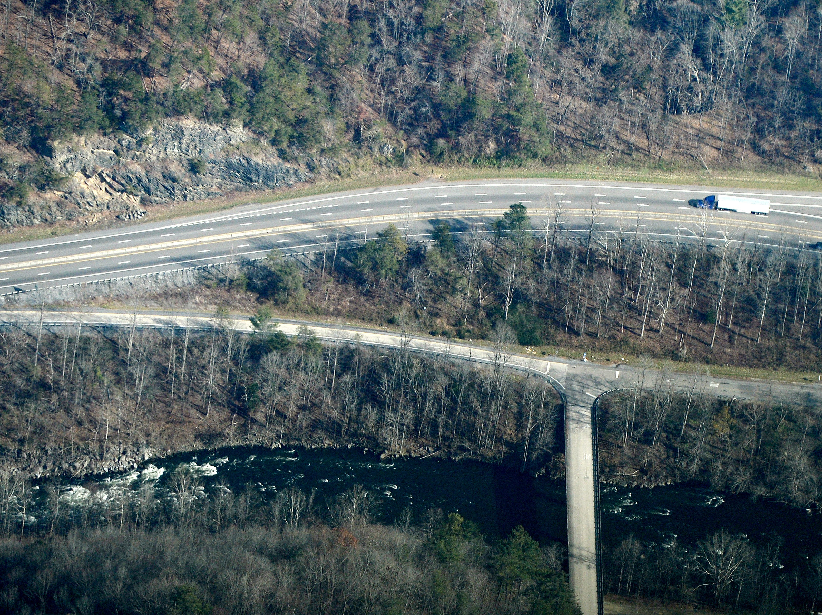 Waterville Road at I-40 exit 451 in Tennessee crossing the Pigeon River is seen from the air on Dec. 6, 2018. The Appalachian Trail crosses over the Pigeon River at this location. Photo made possible by SouthWings.