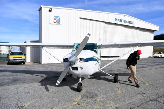 Pilot Hap Endler exits his 1972 Cessna 182P, a fixed-wing single-engine airplane, at the Asheville Regional Airport after a flight on Dec. 6, 2018. Endler is a volunteer pilot with SouthWings, a non-profit conservation organization that uses flight for ecosystem and biodiversity advocacy. Photo made possible by SouthWings.