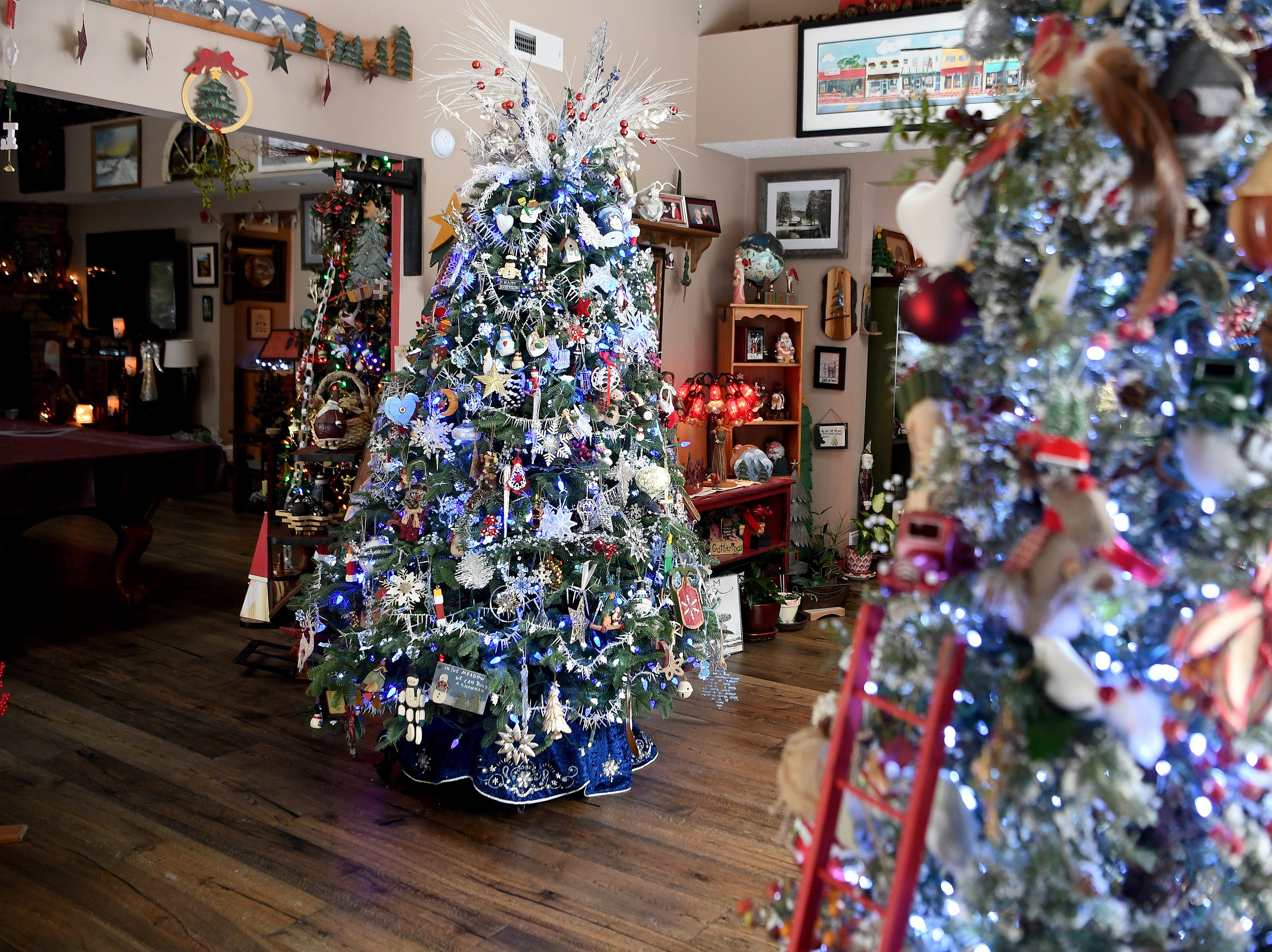 Phyllis and Dave Bryan elaborate decorate their house for Christmas each year with a total of five large trees and several other smaller trees. Each year they invite their friends over for a grand party to enjoy a meal and their decorations.
