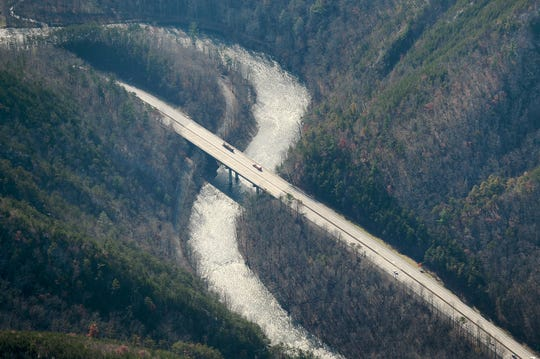A section of I-40 crossing over the Pigeon River in Tennessee near the border with North Carolina is seen from the air on Dec. 6, 2018. The high bridge allows animals such as elk and bears to cross safely under the interstate. Photo made possible by SouthWings.