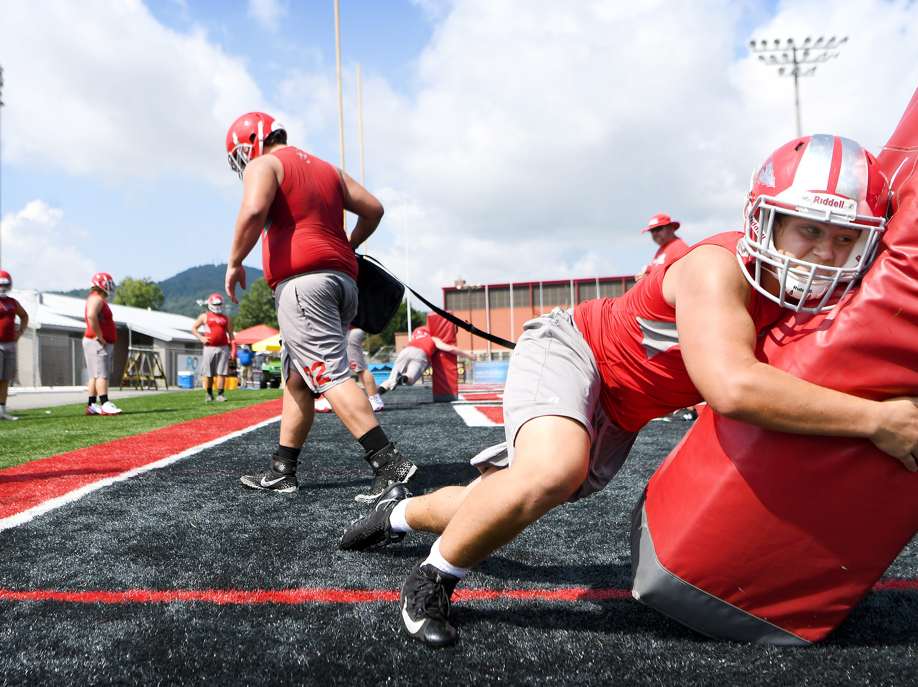 Erwin rising junior Seth Lunsford works on a tackling drill during the first official practice of the season at Erwin High School on Monday, Aug. 30, 2018.